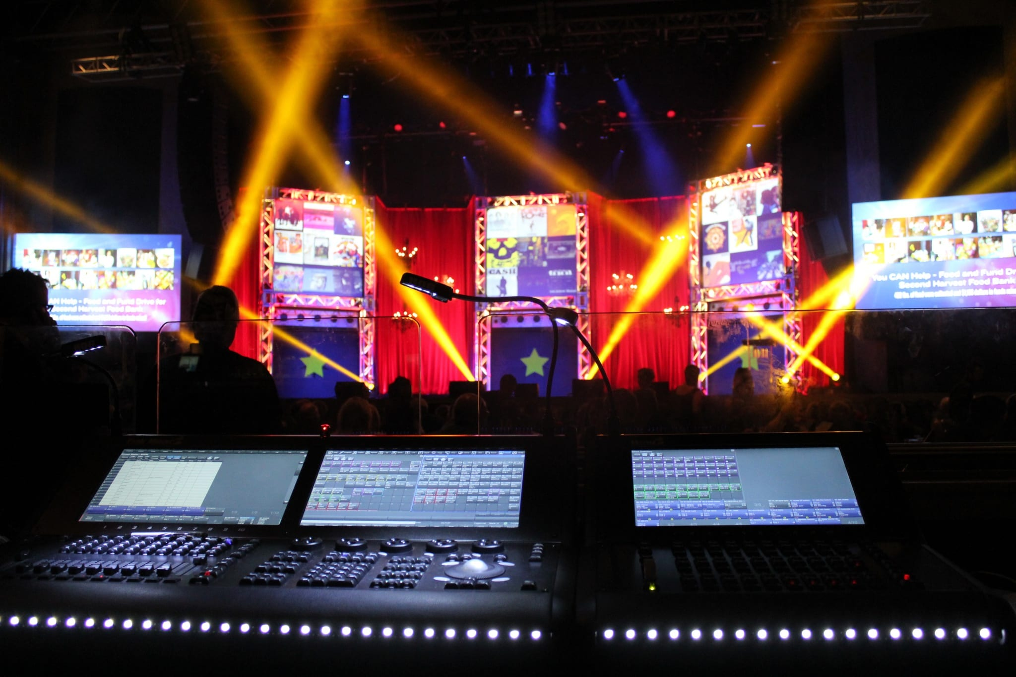 the console where a LD sits to control all of the lights at a live event